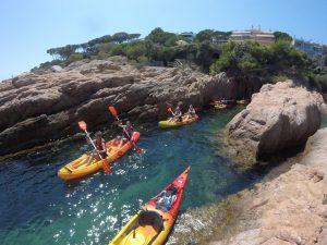 kayaks between rocks